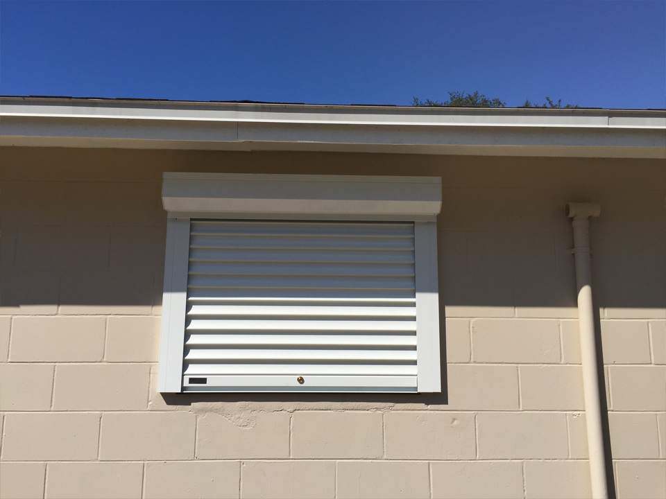 Roll down hurricane shutters photo gallery specialized aluminum products aj 39 s aluminum inc for Roll up window shutters exterior